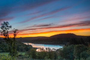 Sunset over lake and trees.png Residents and visitors urged to 'find a bin or take it home' in new litter campaign